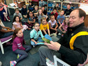 Assistant superintendent reads to John Hole students