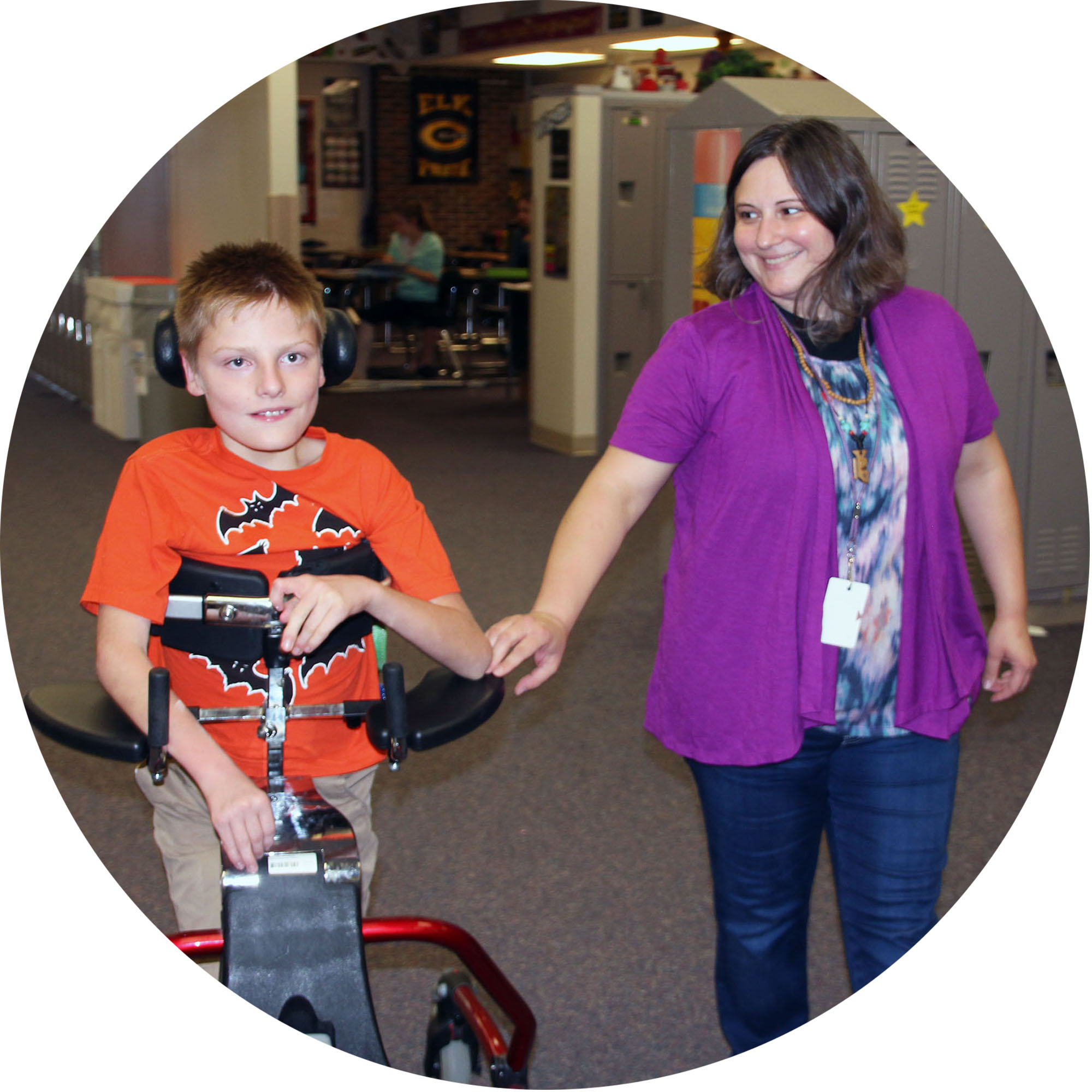 Image of teacher walking with student with special needs