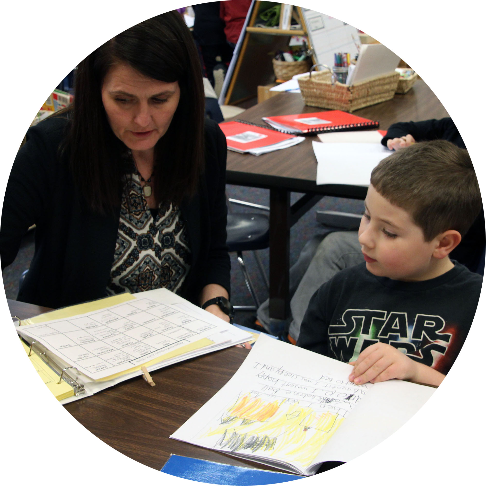 Image of teacher working one-on-one with teacher