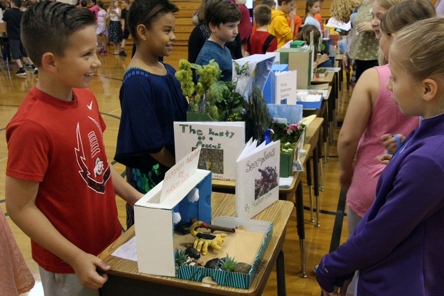 Image of students sharing animal habitat models with other students