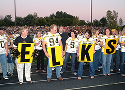 Image of football fans holding Elks sign