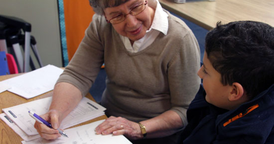 Image of Kay Hoy working with a student