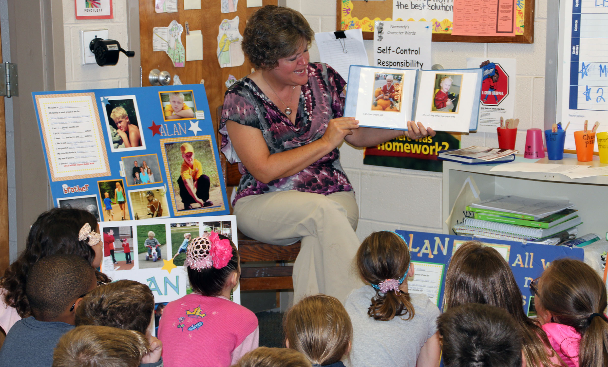 Image of volunteer reading to students