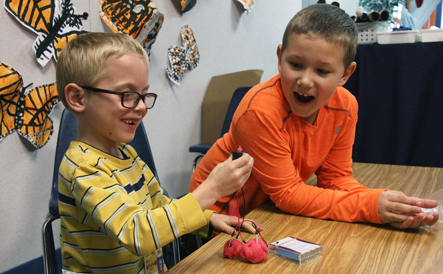 Image of first graders tinkering with circuits