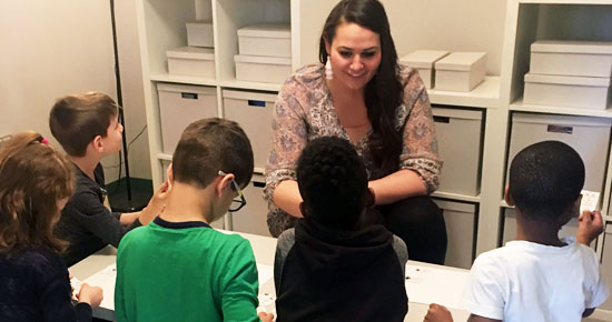 Image of Megan Lunne working with a group of students