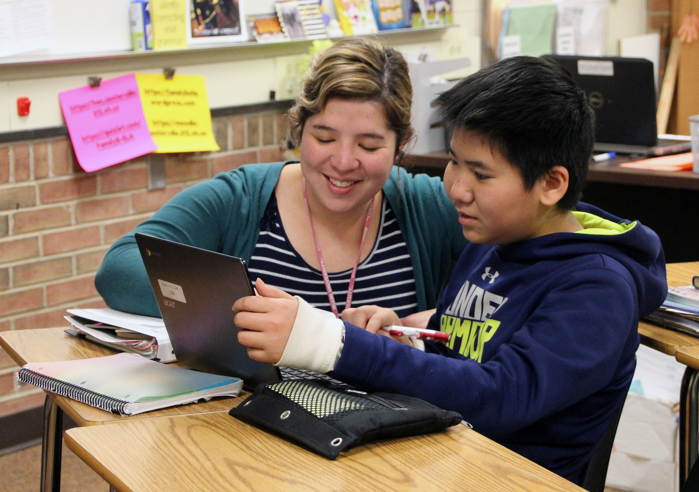 Image of teacher working with ELL student