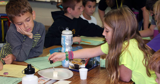 Image of two students working on science experiment